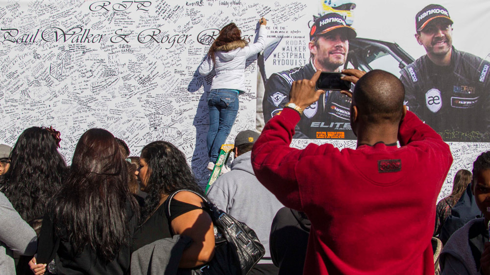 Paul Walker and Roger Rodas are remembered at a memorial road rally in 2013.
