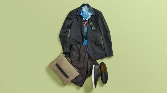 The Row blazer; Valentino silk shirt; Salvatore Ferragamo wool pants; John Lobb leather sneakers; Berluti sunglasses; Tom Ford suede pouch