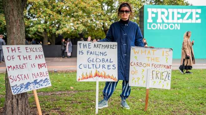 A university lecturer protests about the environmental impact of FriezeFrieze London, London, UK - 03 Oct 2019Frieze London, an annual Art Fair in Regents Park. It brings together more than 160 of the world's leading contemporary galleries, with special curated sections: Focus, showcasing emerging talent; LIVE, a platform for performance art; and new for 2019, Woven, which explores textiles, weaving and the legacies of colonialism. It remains open till 6 Oct 2019.