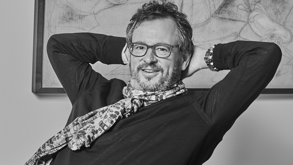 Wirth, wearing a scarf printed with artwork by Jack Whitten