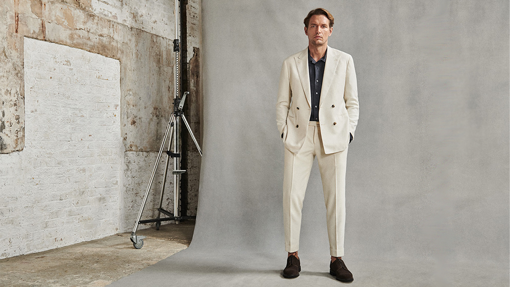 An ivory double-breasted suit from Thom Sweeney's Spring/Summer collection
