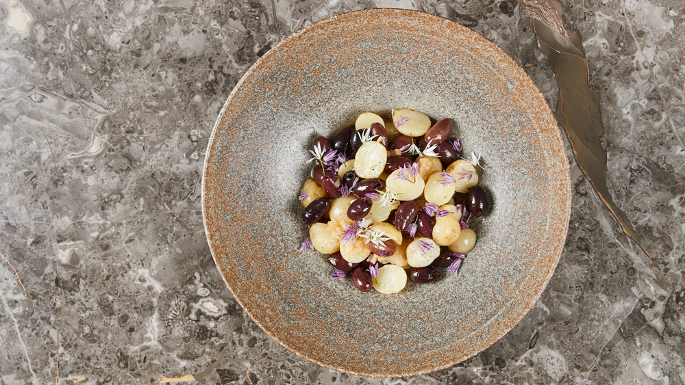 Boiled new potatoes with olives, pickled lemon and black pepper.