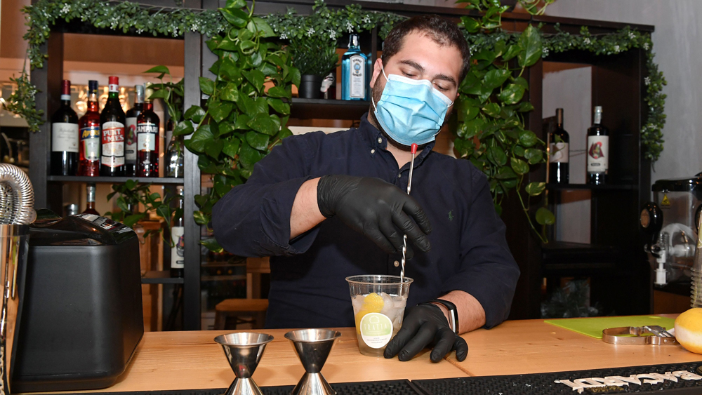 covid bartender mixing drink