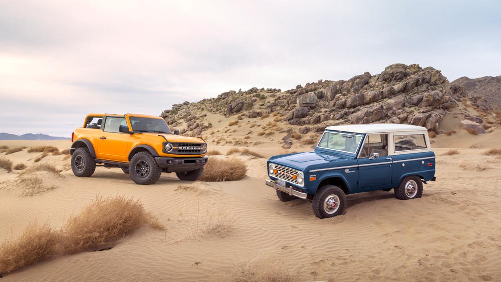 The 2021 Ford Bronco next to the original model.