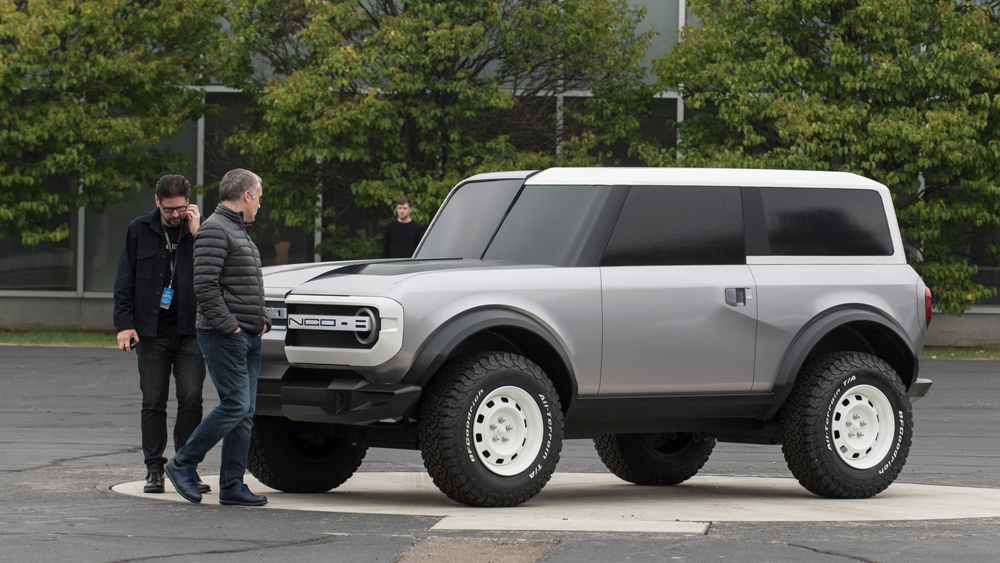 Inspecting a clay model of the 2021 Ford Bronco.