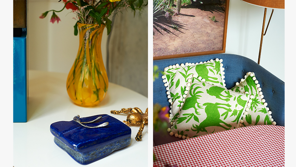 A lapis lazuli paperweight, pewter wishbone, and vase; pillowcases.