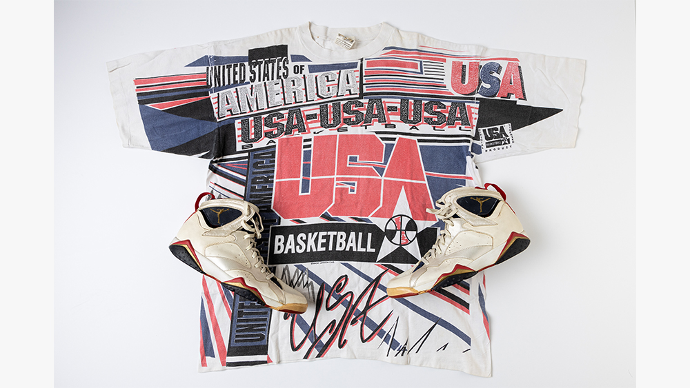 Lot 6 includes a pair of Air Jordan 7's worn in 1992 and a Magic Johnson T-shirt, both gifted to a Spanish hotel receptionist when the dream team stayed in Barcelona.