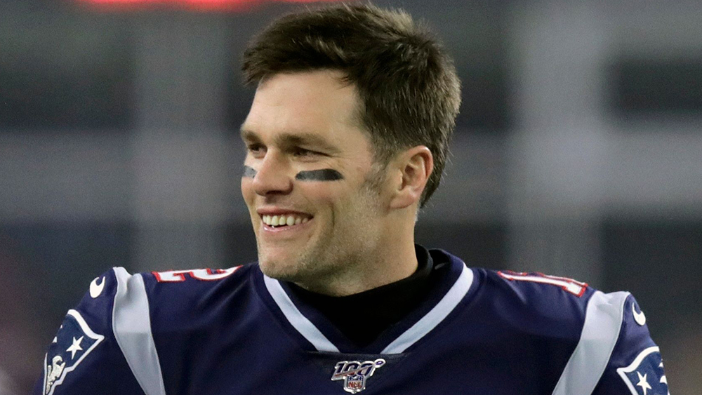 """New England Patriots quarterback Tom Brady walks on the field before an NFL wild-card playoff football game against the Tennessee Titans in Foxborough, Mass. Six-time Super Bowl champion Tom Brady has signed a two-year contract with the Tampa Bay Buccaneers, saying he is embarking on a """"new football journey."""" The 42-year-old quarterback who spent the first 20 years of his career with the New England Patriots announced his decision, in an Instagram post and thanked the Bucs for the opportunityTitans Patriots Football, Foxborough, United States - 05 Jan 2020"""