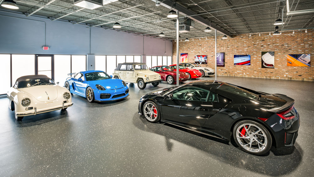 A custom car garage designed by Florida-based DawnElise Interiors International.