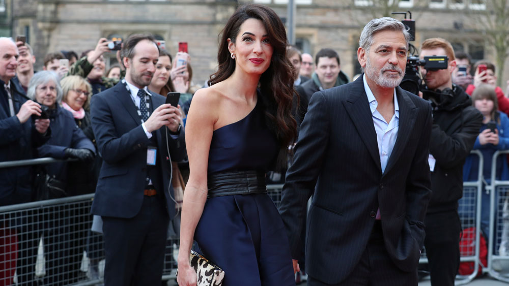 George and Amal Clooney representing the Clooney Foundation for justice at a gala in Edinburgh, Scotland.