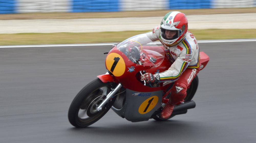 Giacomo Agostini, pilots his MV Agusta 500 at the Phillip Island circuit in Australia in 2015.