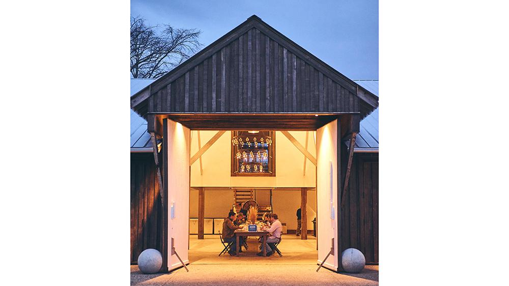 Family dinner inside the Granary Barn at Towerhouse Farm in Georgia.