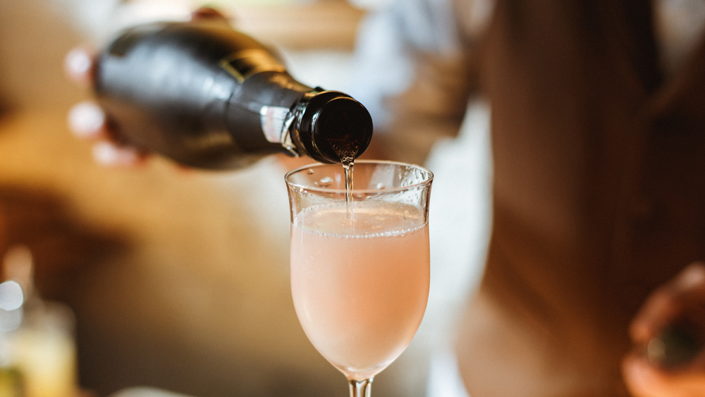 champagne cocktail bartender pouring