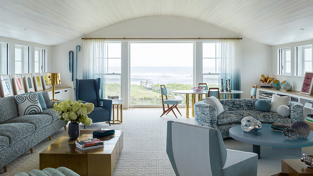 The grown kids' house in the Hamptons features a second-floor living room with an ocean view and a relaxed, comfortable decor.