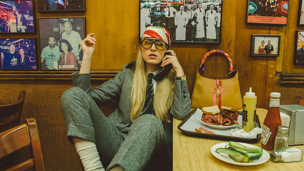 A model wears the new glasses in an F.E. Castleberry suit.