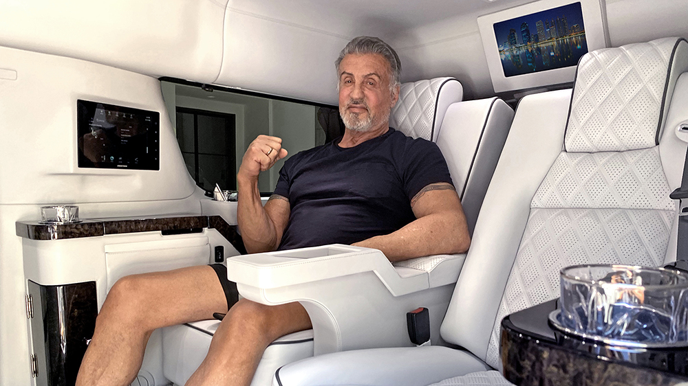 Sylvester Stallone inside his stretched Becker Cadillac Escalade ESV