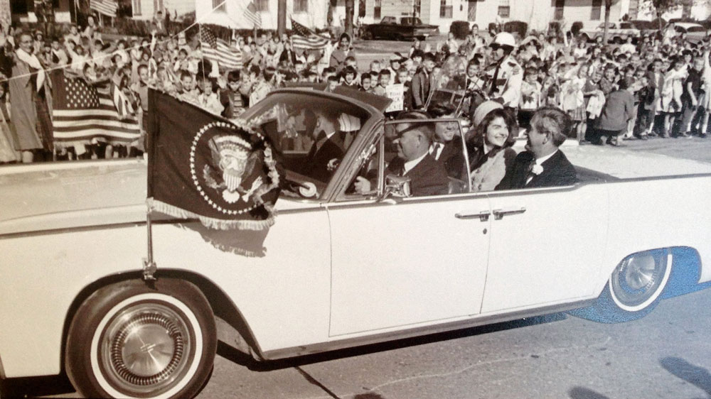 John and Jackie Kennedy in a 1963 Lincoln Continental Convertible.
