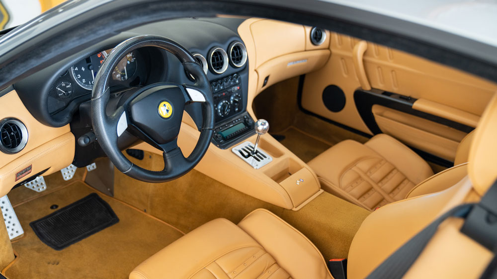 The interior of a 2005 Ferrari 575M with a six-speed manual gearbox.