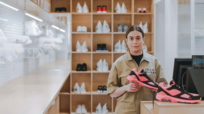 A salesperson prepares sneakers for cleaning at Jason Markk's London store.