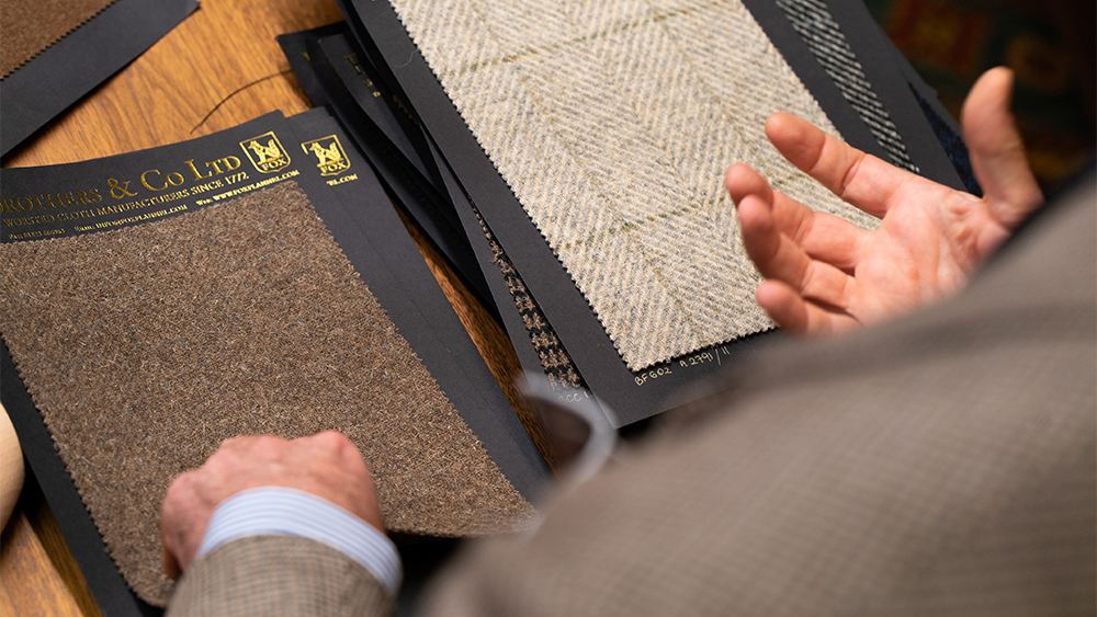 A client selects swatches from Fox Brothers. from Fox