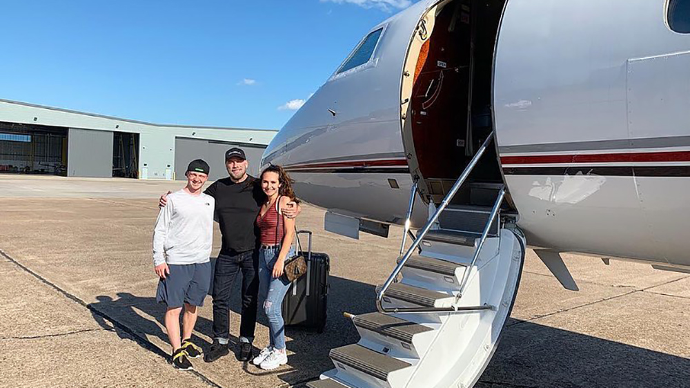 John Travolta and his family with his personal 707