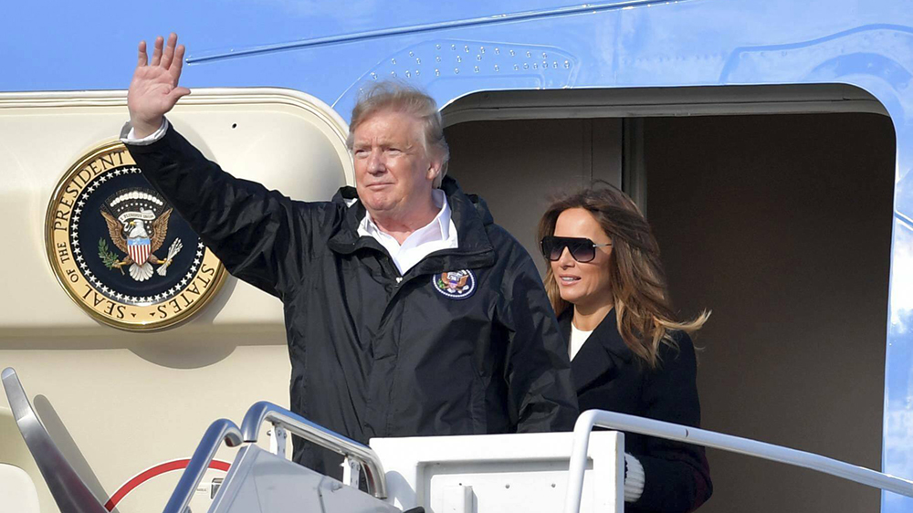 President Trump Visits Alabama following Tornado Devastation and then flies to West Palm Beach. Seen here President Donald Trump fist pumps and waves along with his wife First Lady Melania Trump as they exit Air Force One and greet supporters at the Palm Beach International Airport on March 8, 2019 in West Palm Beach, Florida. CODE: 375968 REF - SMG/Storms Media Group EXPRESS SYNDICATION +44 (0)20 8612 7884/7903/7661 +44 (0)20 7098 2764 NO ONLINE MOBILE OR DIGITAL USE WITHOUT PRIOR PERMISSION (Express Newspapers via AP Images)