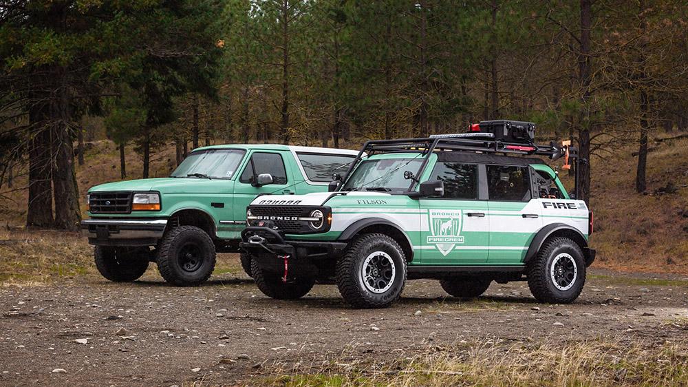 A Ford Bronco + Filson Wildland Fire Rig Concept next to a vintage U.S. Forest Service Bronco