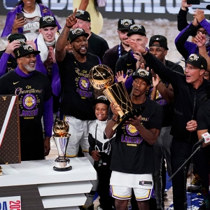 Los Angeles Lakers guard Rajon Rondo holds up the Larry O'Brien NBA Championship Trophy on October 11, 2020