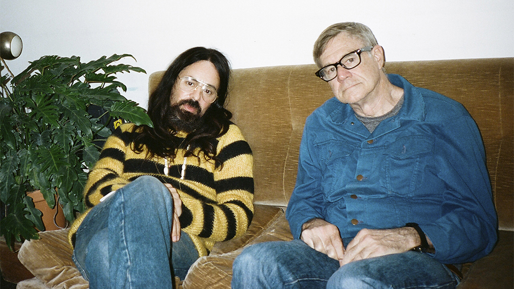 Alessandro Michele and Gus Van Sant behind the scenes during filming.