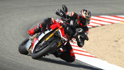 A rider tests a Ducati Streetfighter V4 S during the Ducati Revs event at Weathertech Raceway Laguna Seca.