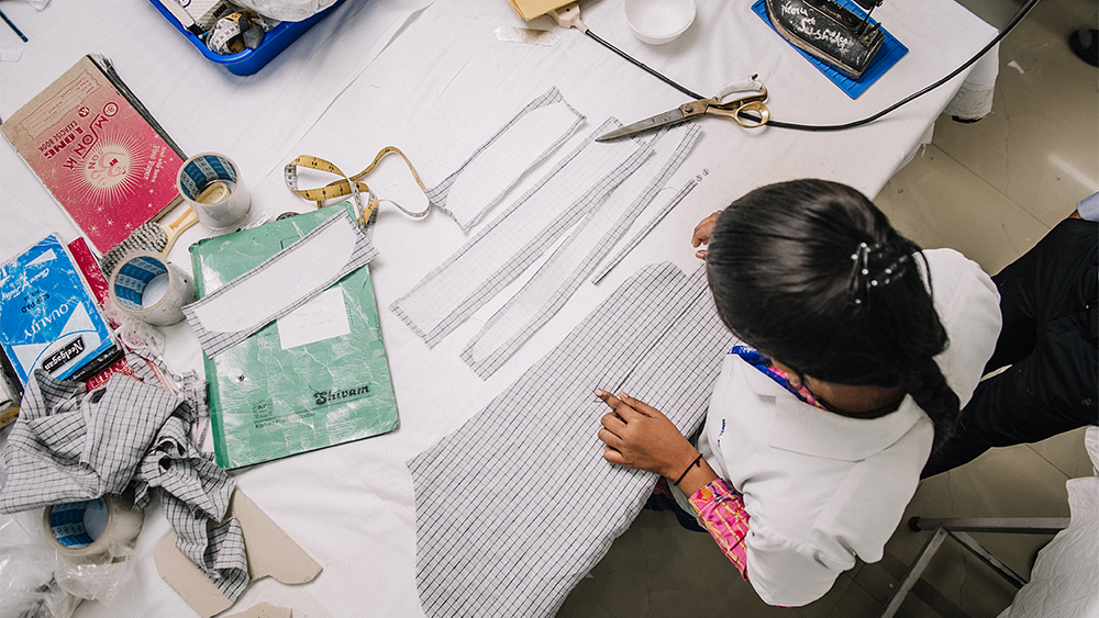 A shirt is assembled at 100Hands' Punjabi atelier.
