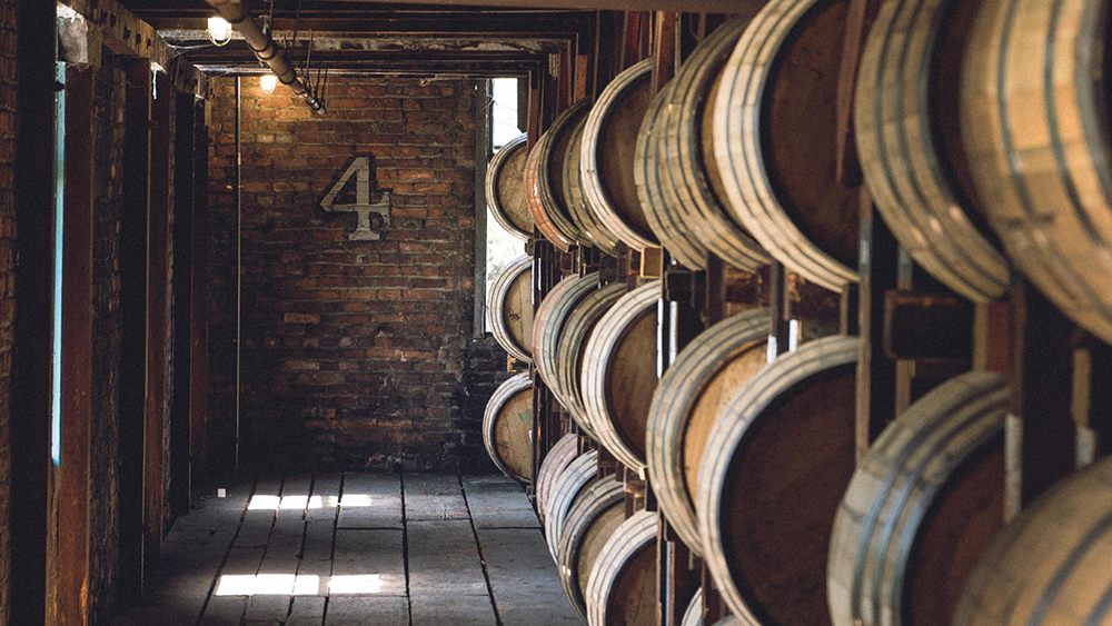 Aisle of barrels in a warehouse