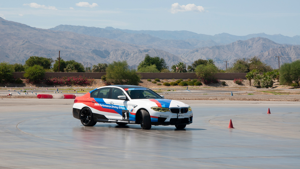 A BMW M5 drifting on the BMW Performance Center West's skid pad.