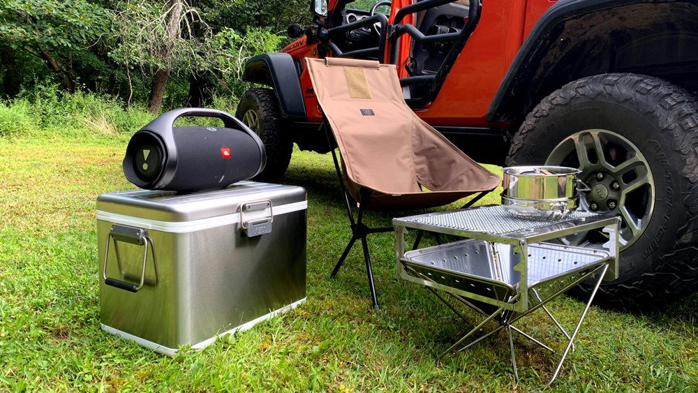 Camping accessories next to a Jeep Gladiator Rubicon.