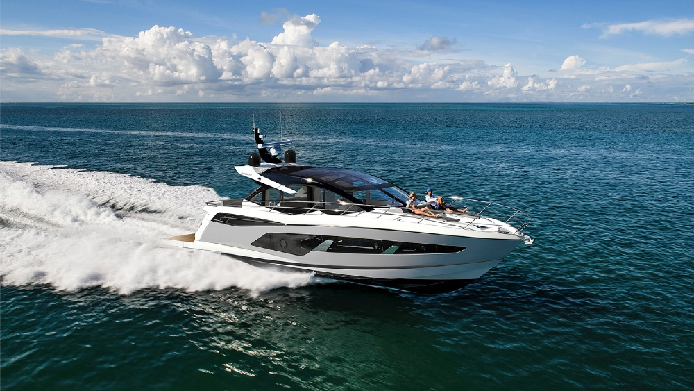 Sunseeker's designers modified the yacht's exterior lines to create a large tk x tk-foot beach club, with storage for a Jet Ski, two Seabobs and a tk-foot inflatable. The beach club has a barbecue bar built into the exterior area, while up on the flybridges is a second integrated barbecue. The flybridge is 25 percent larger than similar yachts, according to Sunseeker, and can be outfitted with an infinity spa pool, wet bar, and glass table for a stunning panoramic view.