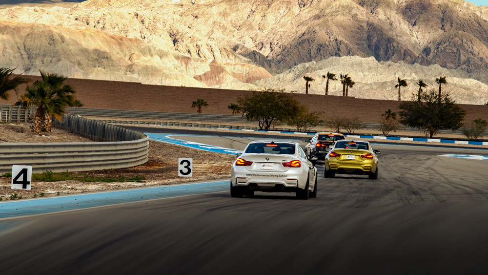 Cars on the track at BMW's Performance Center West.