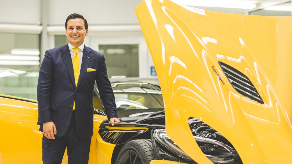 Nicolas Bijan besides his customized Aston Martin supercar
