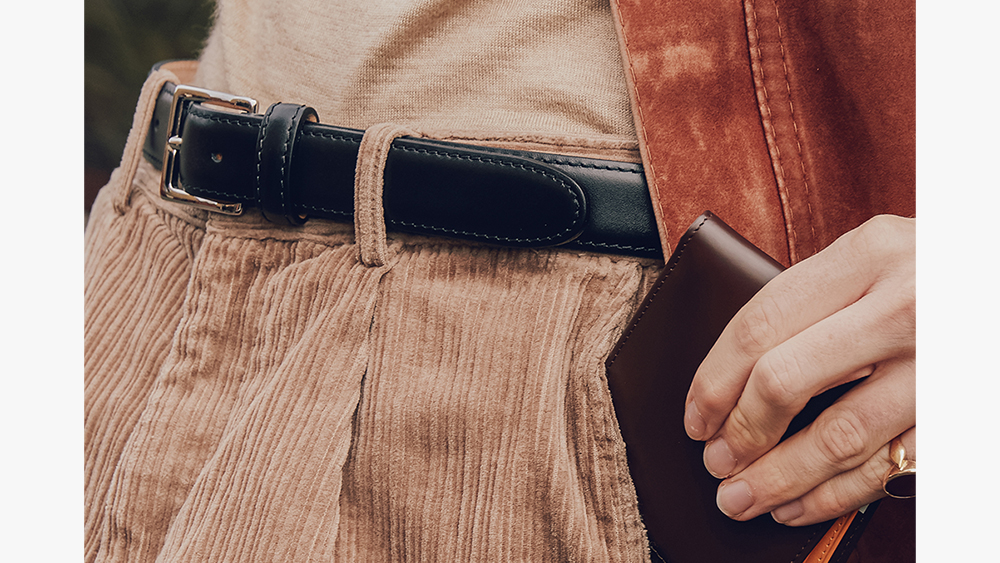 The finishing touches: Ettinger waxy leather belt ($190) and bridle hide billfold wallet ($265).