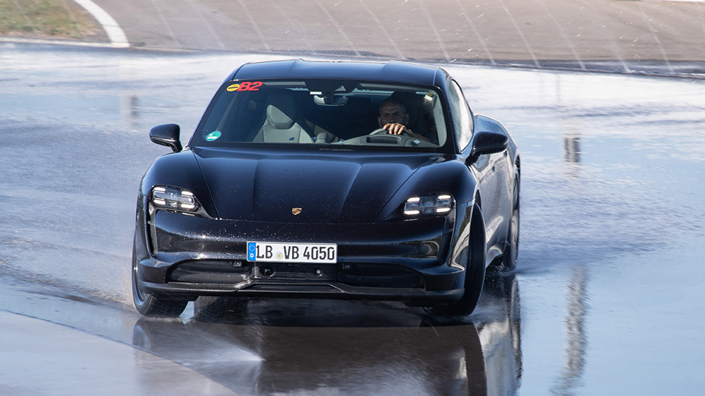 Porsche Taycan setting the Guinness Book of Records mark for longest drift by an electric vehicle