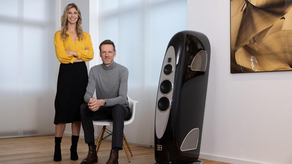Tidal Audio's CEO Jörn Janczak and CMO Miriam Janczak next to the Royale speaker, a collaboration with Bugatti.