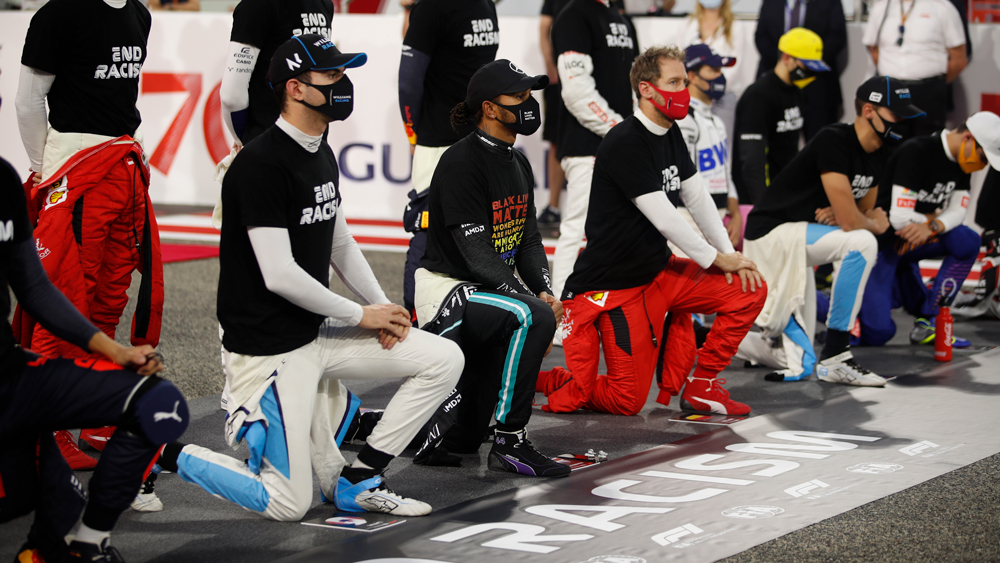 Mercedes driver Lewis Hamilton, Ferrari's driver Sebastian Vettel and other racers take a knee in support of the Black Lives Matter campaign and End Racism Recognition event just prior to the Bahrain Grand Prix.