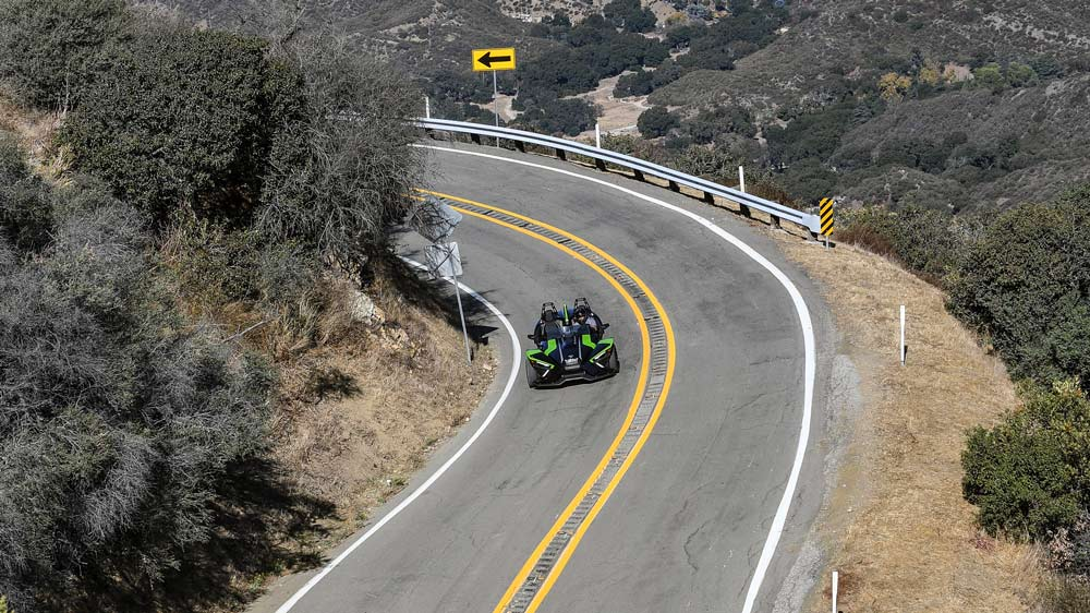 The 2021 Polaris Slingshot SL on a canyon road above Malibu.