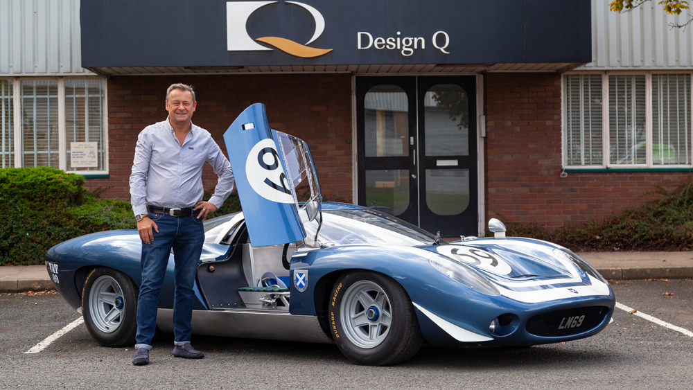 Howard Guy, CEO of Design Q, stands by the Ecurie Ecosse LM69.