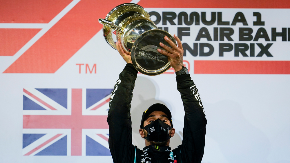 Lewis Hamilton holds the trophy high after his win in the Bahrain Grand Prix.