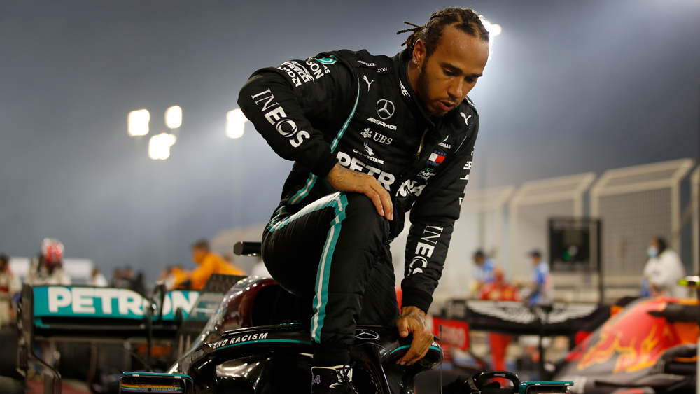 Hamilton exiting is race car after winning the Bahrain Grand Prix.