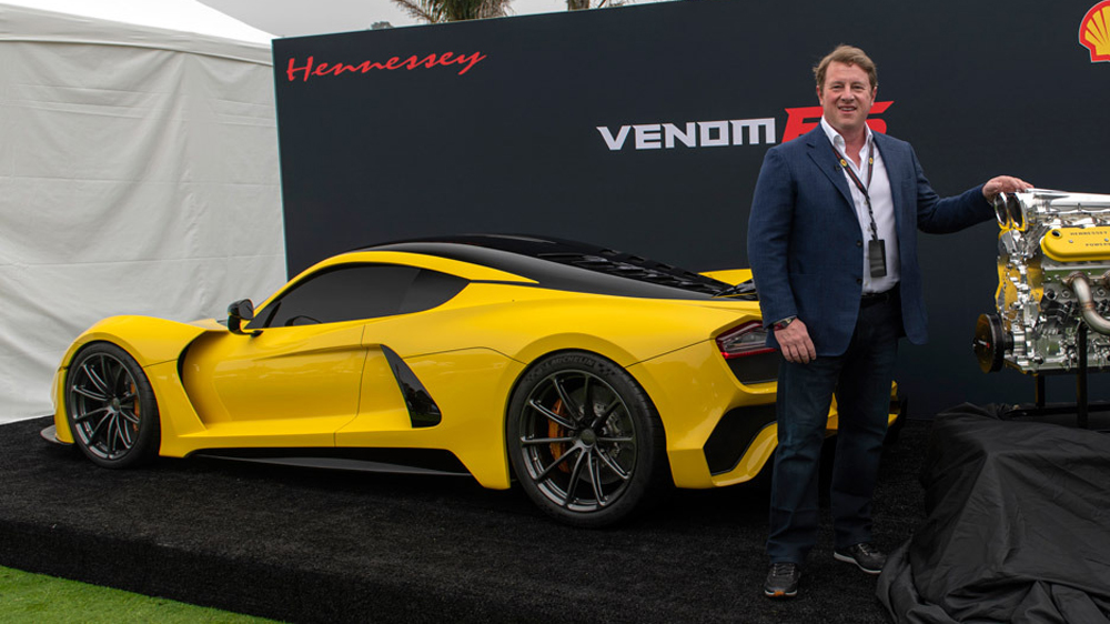 John Hennessey stands with his Venom F5 static prototype and newly developed engine at the Quail Motorsports Gathering in 2018.