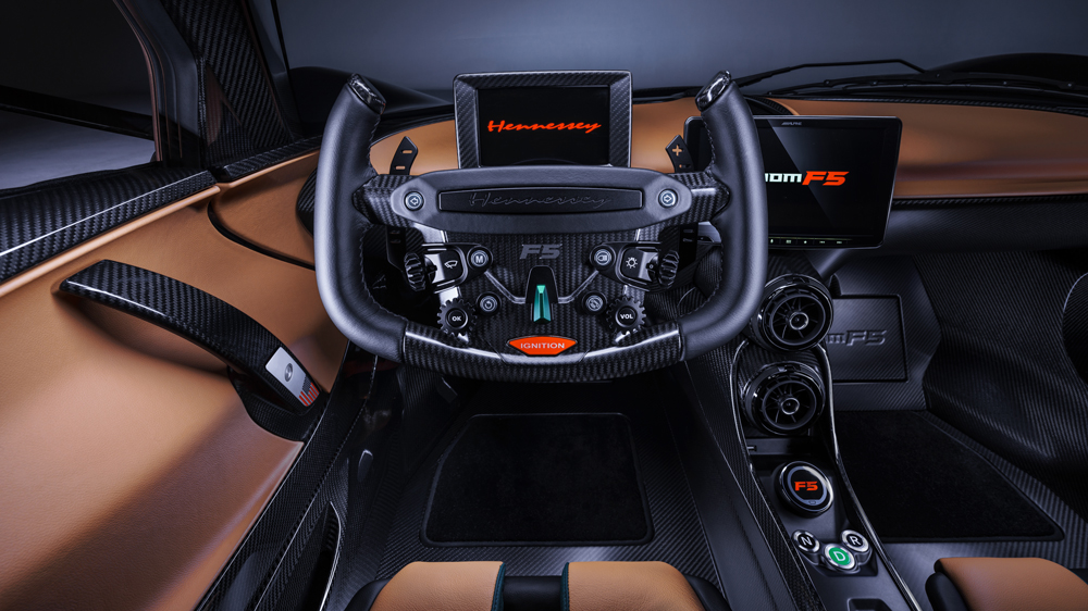 The steering wheel and cockpit of the production version of Hennessey's Venom F5 hypercar.