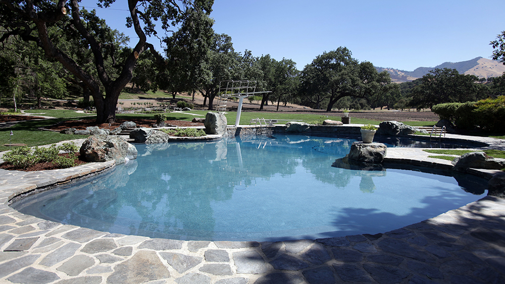 The swimming pool behind the main house is seen at Neverland Ranch in Los Olivos, Calif., Thursday, July 2, 2009. (AP Photo/Carolyn Kaster)