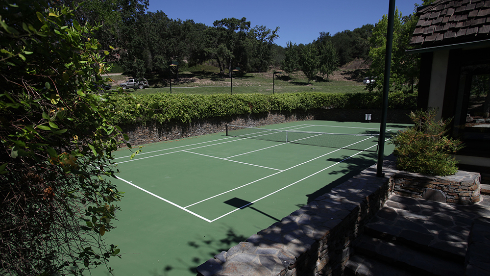A tennis court is seen behind the pool house at Neverland Ranch in Los Olivos, Calif., Thursday, July 2, 2009. (AP Photo/Carolyn Kaster)