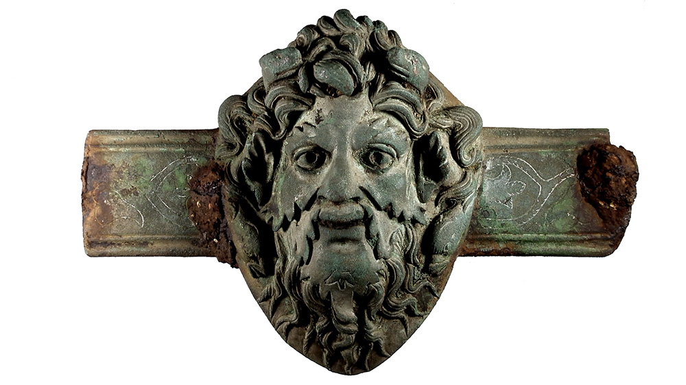 A copper alloy Roman furniture fitting with the face of the god Oceanus